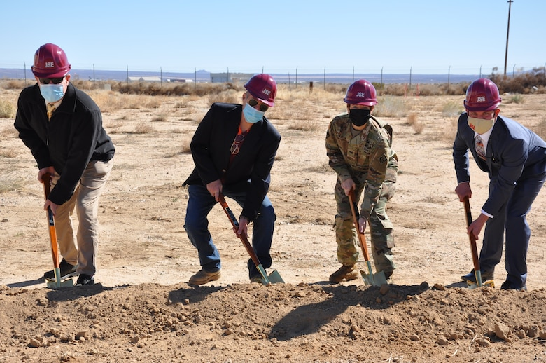 Col. Julie Balten, commander of the U.S. Army Corps of Engineers Los Angeles District, second from right, along with other members of the LA District team, symbolically digs dirt Feb. 18 during a groundbreaking ceremony for the Joint Simulation Environment facility at Edwards Air Force Base, California.
