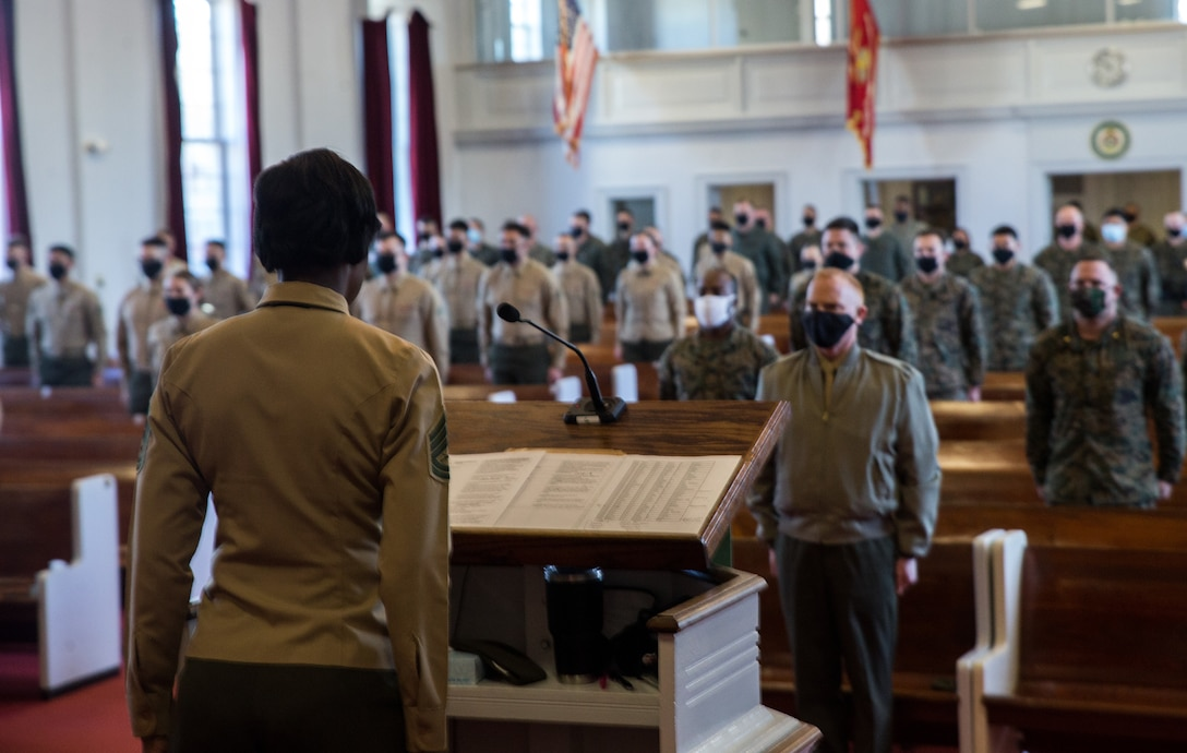 """Marines stand at attention for """"Anchors Aweigh"""" during graduation ceremony for Lance Corporal Leadership and Ethics Seminar, Class 1-21, at Marine Corps Air Station, Cherry Point, North Carolina, January 28, 2021 (U.S. Marine Corps/Michael Neuenhoff)"""