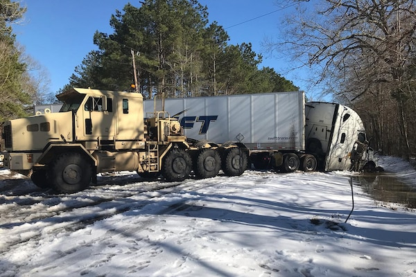 The Louisiana National Guard has been clearing snow and debris from roads in three parishes following a winter storm last week. Guard members also helped Louisiana State Police and transportation officials clear Interstate 20, moving 260 disabled commercial vehicles, Feb. 22, 2021.