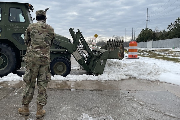 More than 1,200 members of the Louisiana National Guard assisted state officials responding to a winter storm. Guardsmen helped clear roads and move disabled vehicles Feb. 22, 2021.