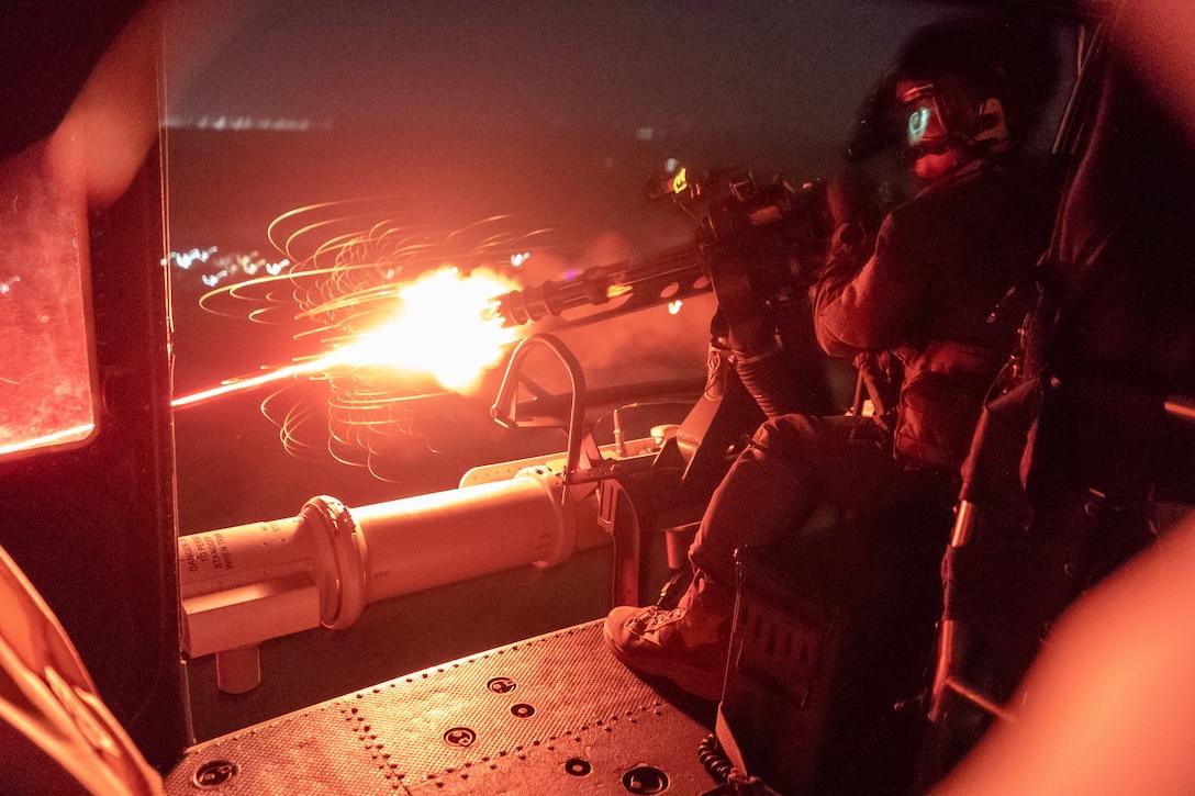 A U.S. Marine fires a Gun Aircraft Unit-17 machine gun from a UH-1Y Venom during a live-fire close-air support training event in Somalia, Dec. 22.