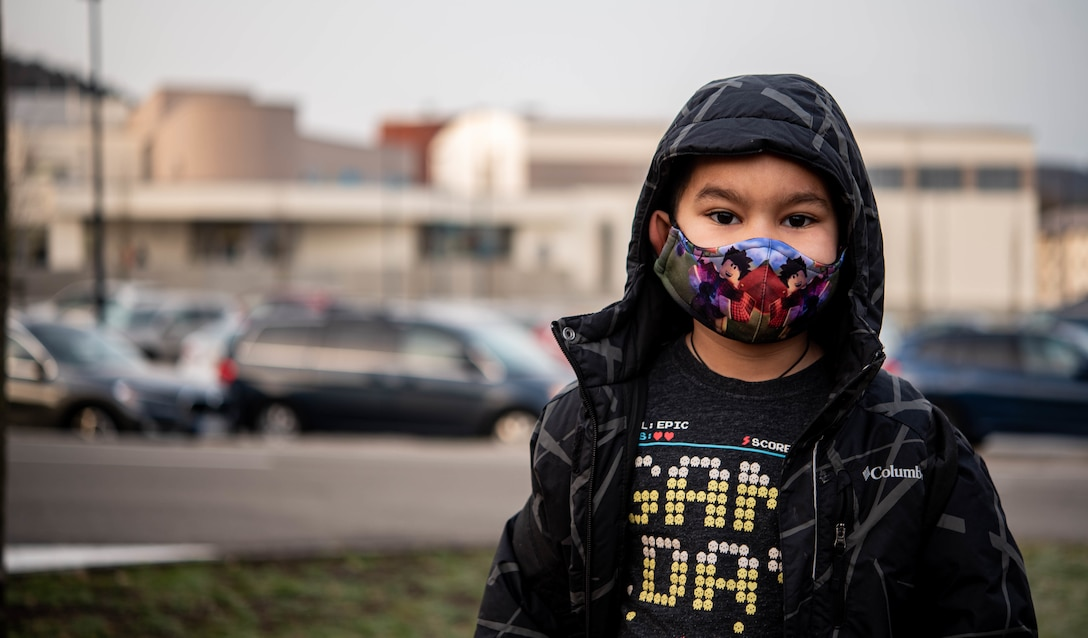 Raiden, son of Airman 1st Class Andrew Alvarado, 86th Airlift Wing public affairs journeyman, poses for a photo in front of Vogelweh Elementary School at Vogelweh Military Complex, Germany, Feb. 22, 2021.