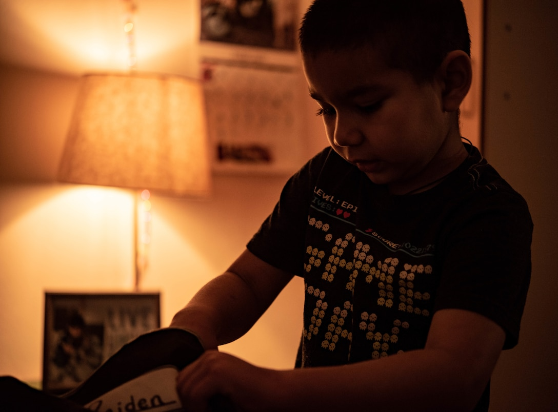 Raiden, son of Airman 1st Class Andrew Alvarado, 86th Airlift Wing public affairs journeyman, fills his backpack with school supplies at Vogelweh Military Complex, Germany, Feb. 22, 2021.
