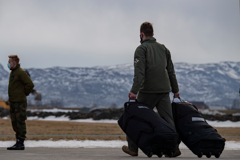 An Airman assigned to the 9th Expeditionary Squadron walks toward a bus at Ørland Air Force Station, Norway, Feb. 22, 2021. The 9th EBS deployed to Norway in support of a Bomber Task Force deployment where they will integrate with ally and partner forces. Integrating with the Royal Norwegian Air Force in the European Theater and the Arctic provides specific and thorough training experience for aircrew. (U.S. Air Force photo by Airman 1st Class Colin Hollowell)