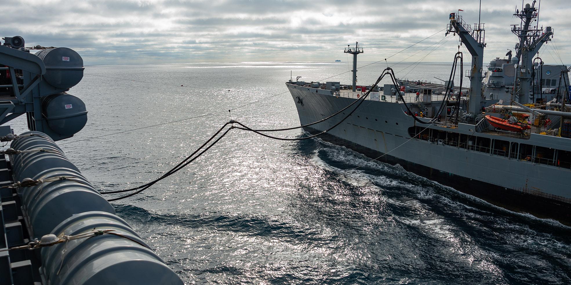 USS Carl Vinson (CVN 70) conducts a replenishment-at-sea with Henry J. Kaiser-class fleet replenishment oiler USNS John Lenthall (T-AO 189).
