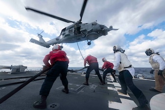 USS Mitscher (DDG 57) conducts helicopter in-flight refueling training with HSM-74.