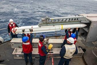 Sailors load a NATO Sea Sparrow missile aboard USS Dwight D. Eisenhower (CVN 69).