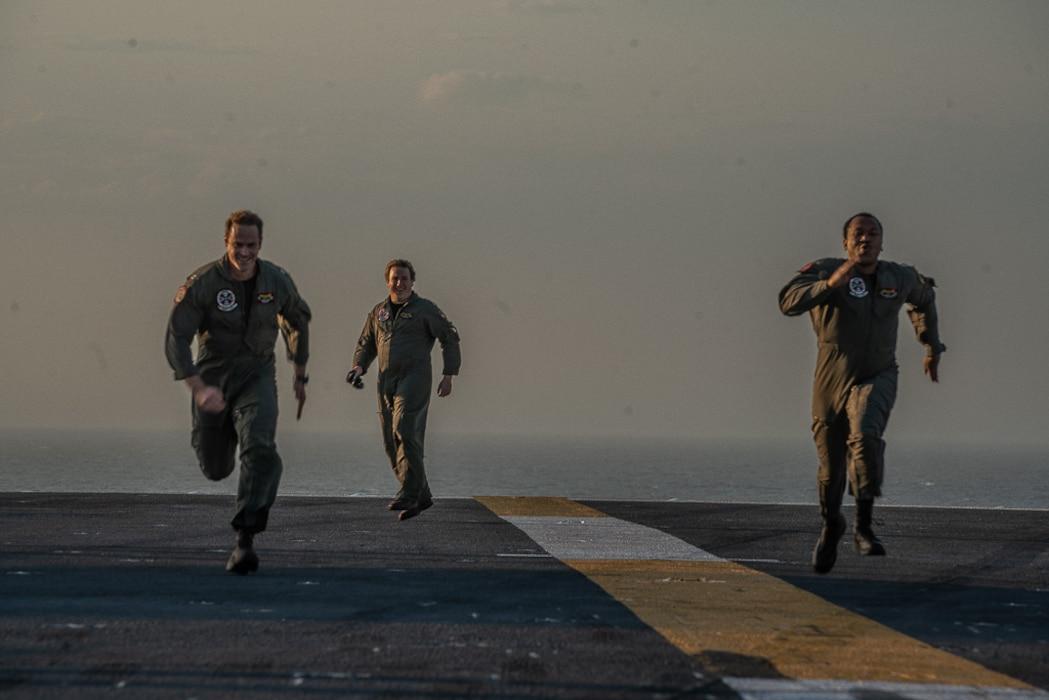 Pilots running on a flight deck
