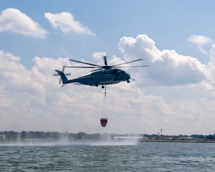 Helicopter lifting water