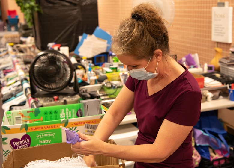 Deborah Skelton, Airman's Attic program director, sorts through various donations in the backroom of the Airman's Attic at Travis Air Force Base, California, on Oct. 17, 2020.