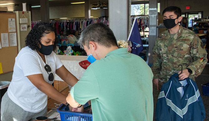 Airman Dynaeja Nimmons assists customers at the Airman's Attic at Travis Air Force Base, California, on Oct. 17, 2020.