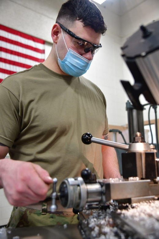 148th Fighter Wing Aircraft Metals Technician, Tech. Sgt. Jason Johnston, uses a lathe to make support equipment on Feb. 21, 2021.  (U.S. Air National Guard photo by Tylin Rust)