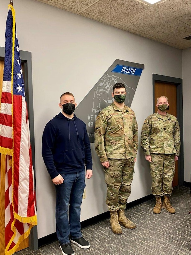 Andy Boso, Tech. Sgt. Jason Johnston and Capt. Josh Kolkind pose for a photo after Boso and Johnston took the Oath of Enlistment on Feb. 2, 2021. (U.S. Air National Guard photo by Audra Flanagan)