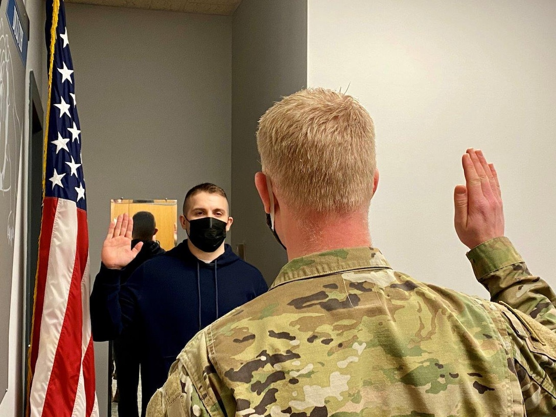 Andy Boso takes the Oath of Enlistment of Feb. 2, 2021.  Boso elected the Aircraft Armament Systems career field.  (U.S. Air National Guard photo by Audra Flanagan