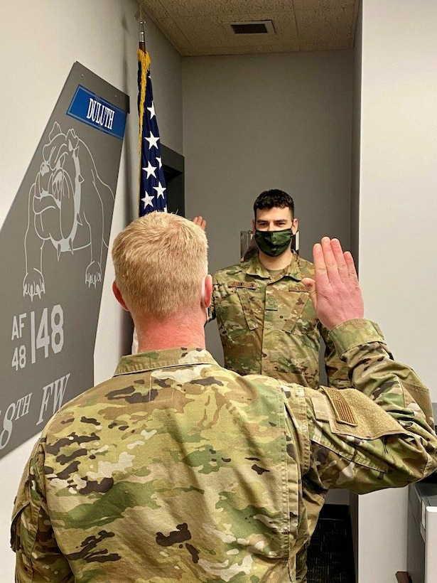 148th Fighter Wing Aircraft Metals Technician, Tech. Sgt. Jason Johnston, takes the Oath of Office during his reenlistment on Feb. 2, 2021.  (U.S. Air National Guard photo by Audra Flanagan)