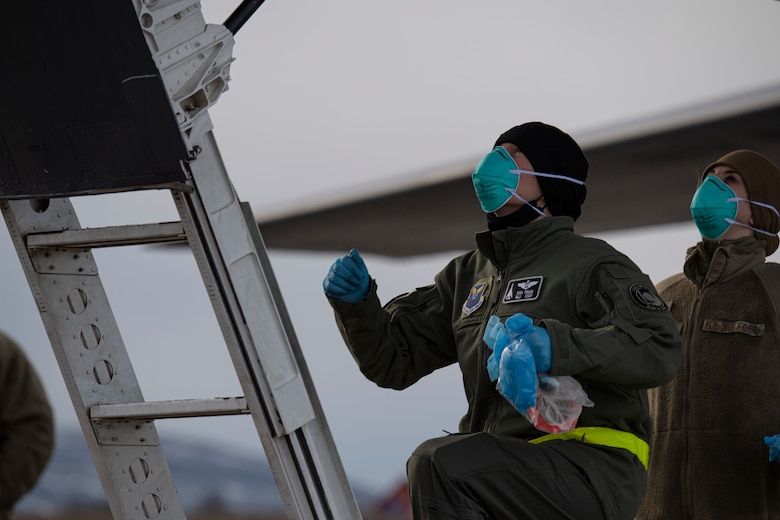 Airmen assigned to the 9th Expeditionary Bomb Squadron prepare to sanitize the cockpit of a B-1B Lancer at Ørland Air Force Station, Norway, Feb. 22, 2021. The 9th EBS underwent a variety of  COVID-19 preventative measures in order to be in compliance with both host nation and Department of Defense requirements. (U.S. Air Force photo by Airman 1st Class Colin Hollowell)