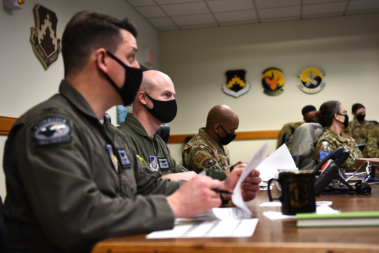 """Wing leadership listen to a presentation during a Wolf Tank in the 8th Fighter Wing conference room at Kunsan Air Base, Republic of Korea, Feb. 17, 2021. Wolf Tank is based on the TV show """"Shark Tank,"""" and is part of the wing's Operation BOLO program, which stands for """"Be on the Lookout for Opportunity."""" Operation BOLO gives Airmen the opportunity to accelerate change and enhance the wing's ability to accomplish the mission, year-round, with Wolf Tanks held periodically to put ideas into action. (U.S. Air Force photo by Senior Airman Suzie Plotnikov)"""