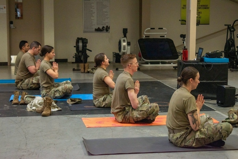 Soldiers participate in a yoga session.