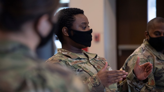 A close-up of a black female officer gesturing while she talks