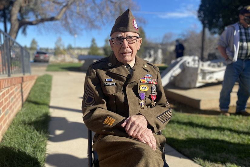 A veteran dressed in army uniform sits for a photo after receiving awards.
