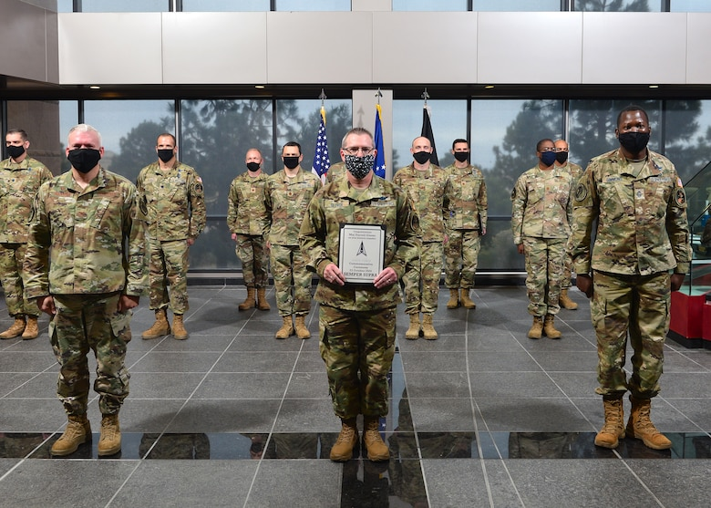Maj. Darrell Glover, Joint Task Force-Space Defense Requirements, Architectures and Analysis Division chief, holds certificate marking his transfer into the U.S. Space Force.