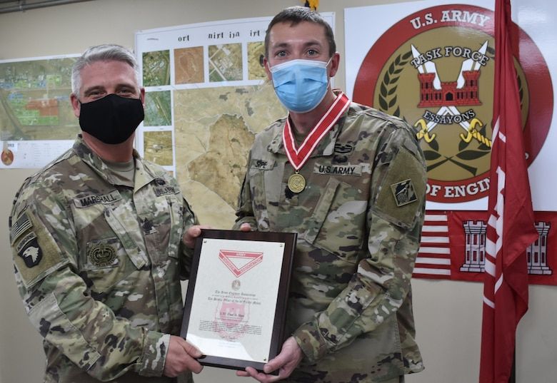 SGM Nathan Marshall and awardee LTC Paul Sipe display the Certificate accompanying the Bronze Order of the de Fleury Medal presented to Sipe February 2, 2021 at Task Force Essayons, Arifjan, Kuwait. (Photo by Rick Benoit)