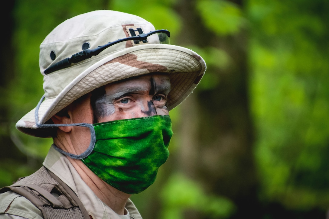 Lt. Col. Daniel Davis, Pilot from the 179th Airlift Wing Operations Group, Mansfield, Ohio, participates in combat survival training May 16, 2019, in Butler, Ohio. The 179th AW has made maintaining readiness while abiding by the COVID-19 safety precautions a priority throughout the COVID-19 Pandemic. (U.S. Air National Guard photo by Senior Airman Alexis Wade)
