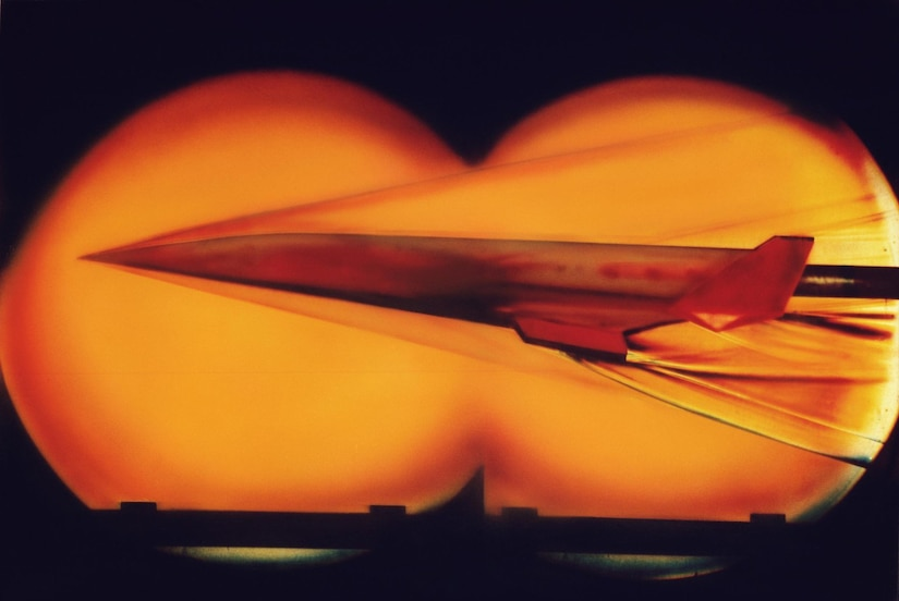 A jet streaks through a wind tunnel.