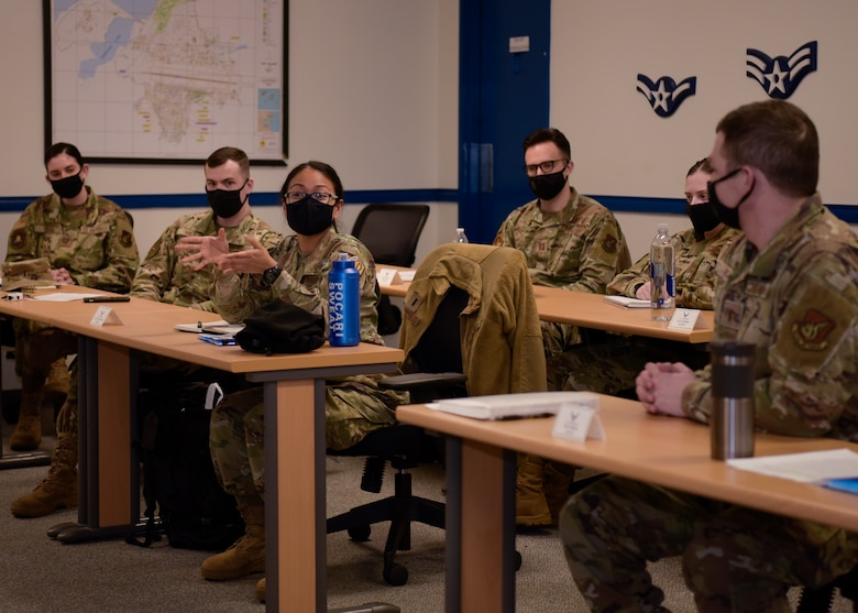U.S. Air Force 1st Lt. Joede Stonebraker, a 35th Surgical Operations Squadron clinical nurse, asks the panel of Majors a question on leadership during the last seminar of the First Term Officers Course (FTOC) at Misawa AB, Japan, Feb. 19, 2021. The conclusion of FTOC gave the attendees an opportunity to ask questions and receive guidance and mentoring from a panel of Field Grade Officers. (U.S. Air Force photo by Airman 1st Class Joao Marcus Costa)