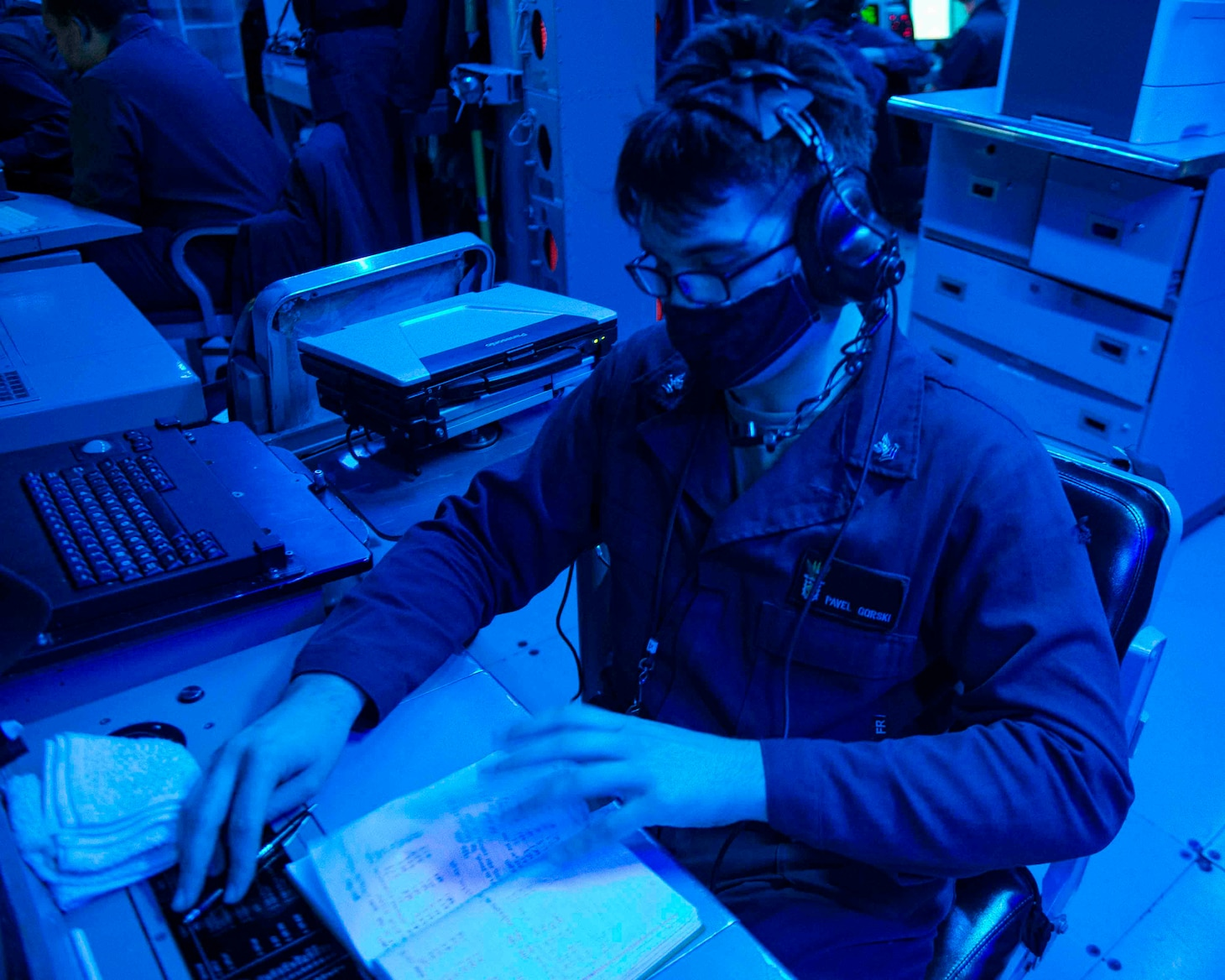 TAIWAN STRAIT (Feb. 23, 2020) -- Fire Controlman (Aeigis) 2nd Class Pavel Gorski, from St. Petersburg, Fla. writes in a watch log aboard the Arleigh Burke-class guided-missile destroyer USS Curtis Wilbur (DDG 54). Curtis Wilbur is assigned to Destroyer Squadron (DESRON) 15, the Navy's largest forward-deployed DESRON and the U.S. 7th Fleet's principal surface force.