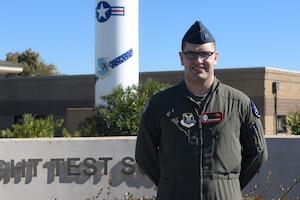 Minuteman III operator poses for a photo at a Minuteman Missile display at Vandenberg Air Force Base, California.