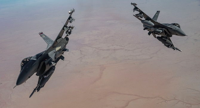 Two U.S. Air Force F-16 Fighting Falcon pilots depart after receiving fuel from a KC-135 Stratotanker, assigned to the 340th Expeditionary Aircraft Refueling Squadron, while flying routine operations over Southwest Asia Feb. 16th, 2021.