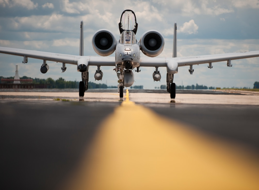 U.S. Airmen with the Indiana Air National Guard return home to waiting family and loved ones, July 27, 2018, at the 122nd Fighter Wing, Fort Wayne, Ind. The Blacksnakes deployed approximately 300 Airmen along with their squadron of A-10C Thunderbolt II aircraft to Afghanistan for over three months in support of Operation Freedom's Sentinel. (U.S. Air National Guard photo by Tech. Sgt. William Hopper/Released)
