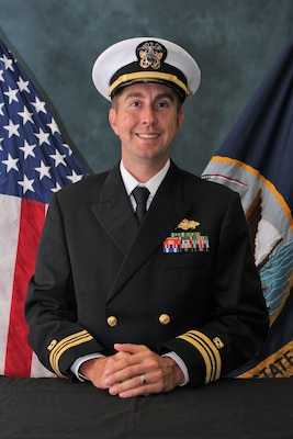 Official portrait of Lt. Cmdr. Richard E. Buechel.