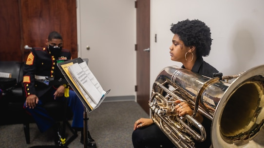 Grace Tifford, right, an applicant with Recruiting Substation (RSS) Rockville, Recruiting Station Frederick, auditions for the Musician Enlistment Option Program at RSS Rockville, Md., on February 23, 2021. The audition required Tifford to play multiple preselected audition excerpts selected by Master Sgt. Justin A. Hauser, the musical technician assistant, for the 4th Marine Corps District to evaluate her proficiency. (U.S. Marine Corps photo by Cpl. Cody J. Ohira)