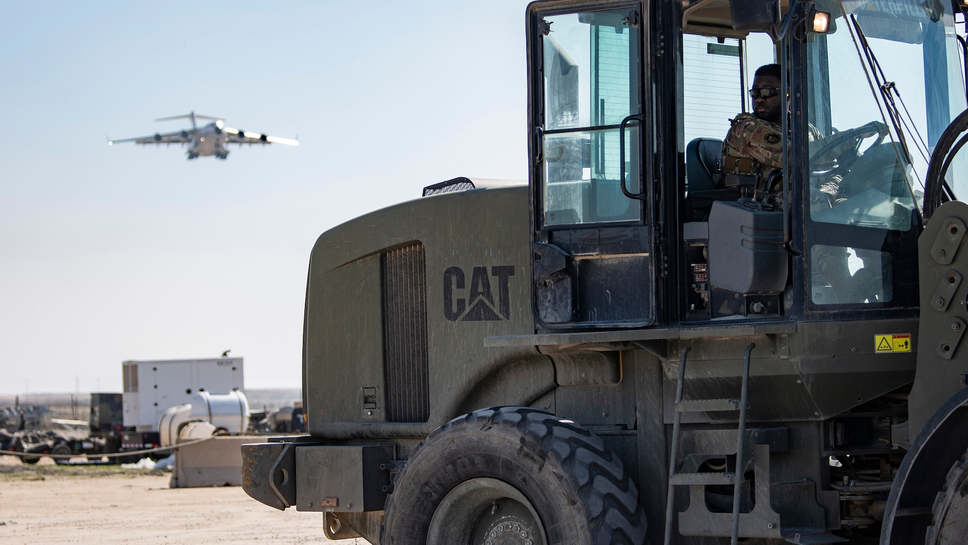 A photo of an Airman driving machinery