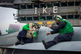 Sailors maintain aircraft aboard USS Dwight D. Eisenhower (CVN 69).