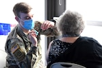 A Soldier with the Michigan Army National Guard administers a first dose of the COVID-19 vaccine during a mass vaccination clinic in Traverse City, Michigan, Feb. 23, 2021. The Michigan National Guard is helping local health care organizations vaccinate Michiganders.