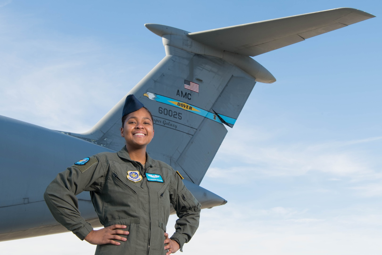 Airman 1st Class Savannah Ferguson, 9th Airlift Squadron loadmaster, celebrates Black History Month by representing various minority groups at Dover Air Force Base, Delaware, Feb. 17, 2021. The daughter of a Puerto Rican mother and Jamaican father, Ferguson grew up as a bridge between Hispanic and African-American cultures. After being assigned to Dover Air Force Base, Ferguson recognized that she had a personal responsibility as a female, Hispanic and African-American Airman within a predominantly white, male career field to share her experiences in promotion of diversity and inclusion. (U.S. Air Force photo by Mauricio Campino)