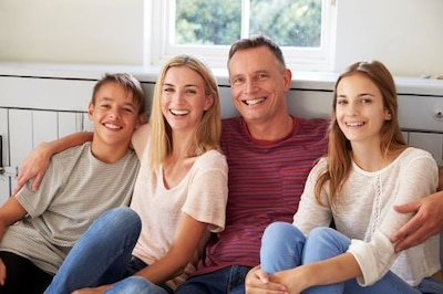 Smiling family on seat at home.