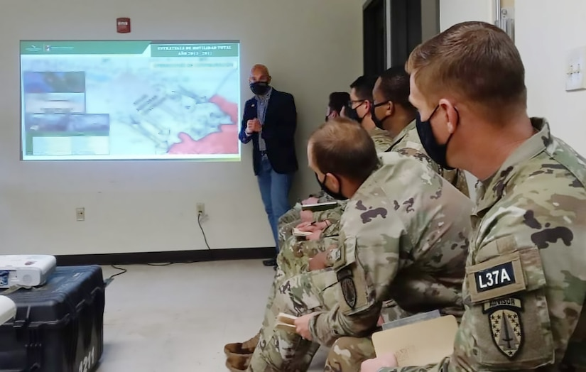 WHINSEC Instructor and former Colombian Army Senior Enlisted Advisor, CSM(RET) Argemiro Posso, briefs members of the 1st Security Force Assistance Brigade (1SFAB) on criminal activity challenges affecting U.S. Southern Command (USSOUTHCOM) Area of Operations (AO). As part of the partnership between WHINSEC and 1SFAB, Institute's Partner Nation Instructors interact with 1SFAB teams in order prepare them for future engagements in the AO.