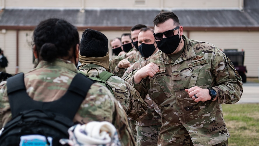 Airmen from the 2nd Bomb Wing are greeted by Col. Mark Dmytryszyn, 2nd BW commander, and other base leaders upon returning to Barksdale Air Force Base, La., Feb. 24, 2021, after a Bomber Task Force deployment to Andersen Air Force Base, Guam. The BTF brought B-52H Stratofortress bombers and 2nd BW Airmen to the Indo-Pacific theater to test their ability to integrate and operate from a forward location. (U.S. Air Force photo by Airman 1st Class Jacob B. Wrightsman)