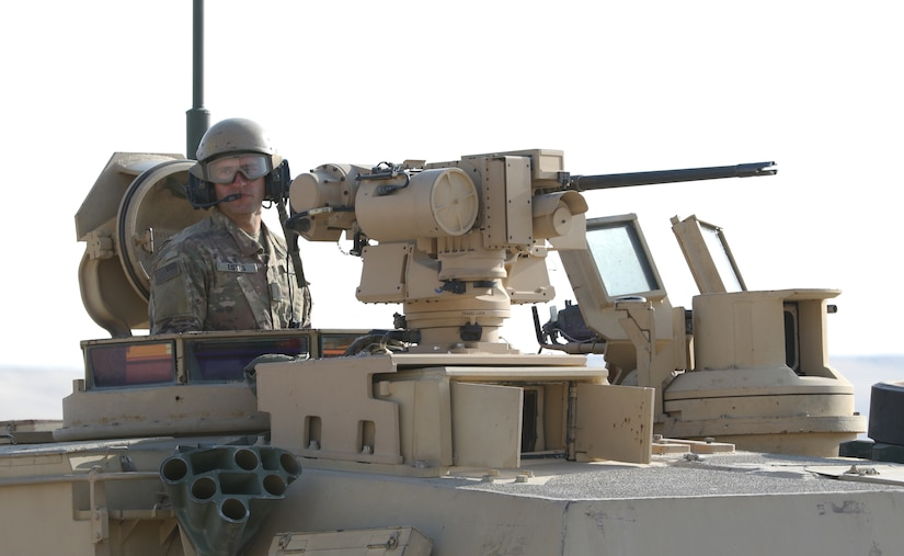 A U.S. Army Soldier assigned to 1st Battalion, 6th Infantry Regiment, 2nd Brigade Combat Team, 1st Armored Division, provides security in an M-1 Abrams tank while waiting for an air medevac training mission to begin, Feb. 2, 2021, during Iron Union 14 at Al Hamra Training Center in United Arab Emirates. Iron Union is a recurring, bilateral exercise between Task Force Spartan and UAE Land Forces that is a unique opportunity to train with our partners in exercising critical crisis response capabilities.