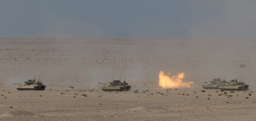 U.S. Army M1 Abrams tanks from 1st Battalion, 6th Infantry Regiment, 2nd Brigade Combat Team, 1st Armored Division, launch rounds down range during a live-fire exercise portion of Iron Union 14 at Al Hamra Training Center in the United Arab Emirates, Feb. 4, 2021. Iron Union is a recurring, bilateral exercise that is designed for U.S. forces to train with UAE counterparts in addressing common threats to regional security in Southwest Asia.