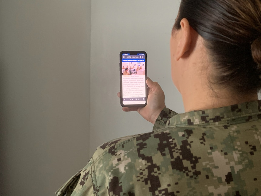 A Sailor uses the DANTES MilEd Benefits mobile app to view Navy College Program education information. The Navy College Program mobile app will sunset Feb. 26 and transition to the DANTES MilEd Benefits mobile app, a single source for all education information.