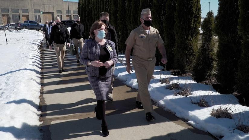 Strategic Command's senior leader Adm. Charles Richard walks outside with Strategic Missions Chief Strategist Monica Hutchins.