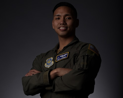 Airman Crosses his arms and smiles