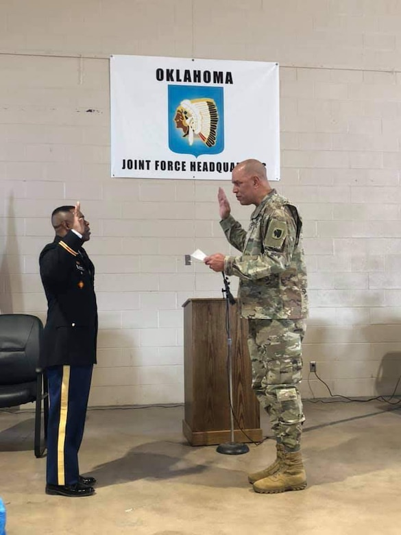 Second Lt. Bennie Brown (left) is sworn-in as an Army officer by Maj. Gen. Michael Thompson (right), the adjutant general for Oklahoma, during his commissioning ceremony at the Oklahoma National Guard Joint Force Headquarters in Oklahoma City, April 3, 2019. Brown is the oldest African American officer and one of the oldest officers ever to graduate the engineer officer course at Fort Leonard Wood, Missouri. (photo illustration provided by 2nd Lt. Bennie Brown)