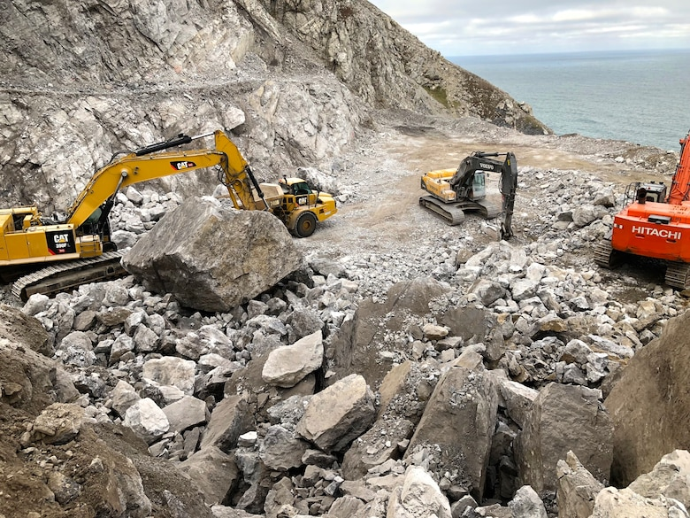 Workers excavate rocks from a quarry on property managed by the U.S. Fish and Wildlife Service near Cape Lisburne on Sep. 24, 2019.