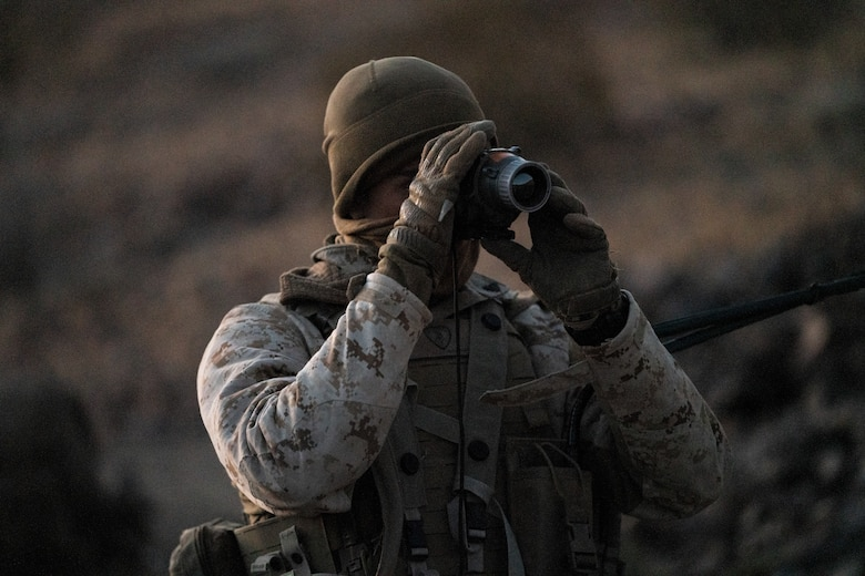 A Marines with 2nd Battalion, 3rd Marines, checks and adjusts a thermal optic at the Marine Corps Air Ground Combat Center, Twentynine Palms, on February 17, 2021. Marines used Marine Warfighting Exercise to strengthen their skills and tactics for fighting a near peer adversary. (U.S. Marine Corps photo by Lance Cpl. Andrew R. Bray)